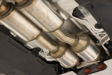 Catalytic converter. Exhaust system of a modern car bottom view.