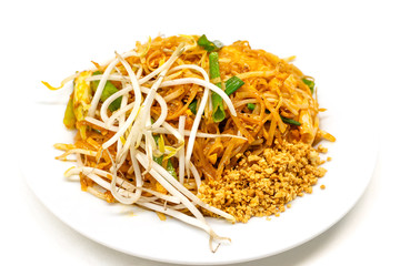 Dish of Pad thai on white background.Pad thai or phad thai, is a stir-fried rice noodle dish commonly served as a street food and at most restaurants in Thailand as part of the country's cuisine.