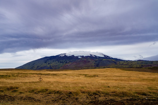 Snow mountain range under the ominous clouds -- Iceland