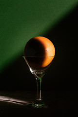 Yellow Grapefruit in Martini Glass with Sun and Shadows