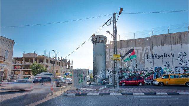 The Israeli West Bank barrier is a separation barrier timelapse hyperlapse. Bethlehem, Palestine.
