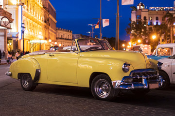 Printed roller blinds Vintage cars yellow classic convertible car in the city of havana at night with dark blue sky and reflecting lights
