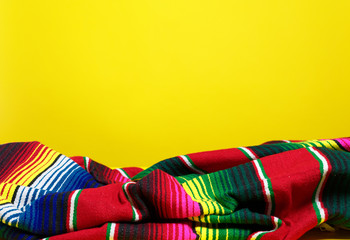 Colorful Mexican serape blanket on a yellow background Wall mural