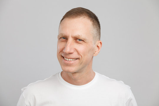 middle-aged man headshot in a white t-shirt