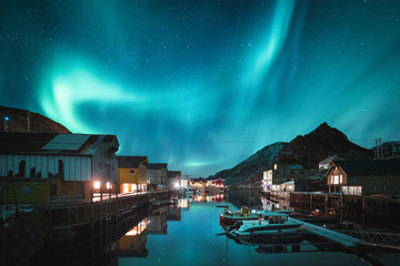 Norway, Vesteralen archipelago, Langoya island, Nyksund, Northern lights above fishing village