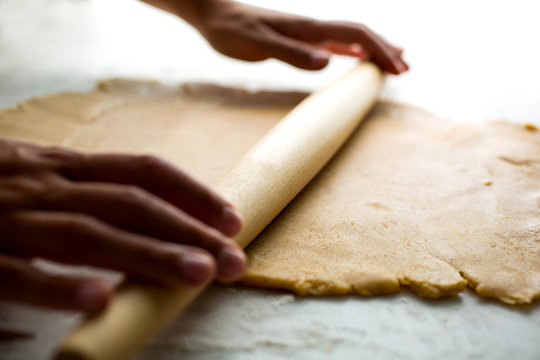 Straight on angle view of rolling out dough