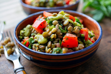 Close up of lentil salad with fava beans served in bowl