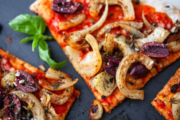 Directly above view of sliced pizza with olives and grilled fennel