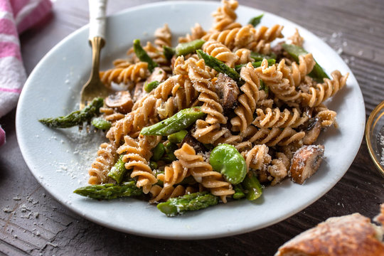 Close up of whole grain pasta with mushrooms served on plate