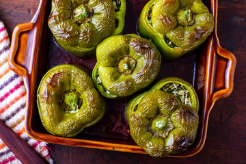 Directly above view of peppers stuffed with rice in tray