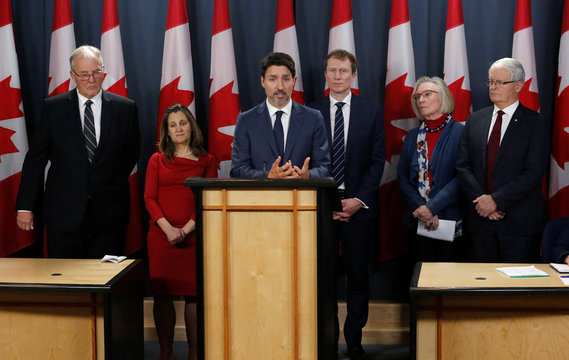 Canada's Prime Minister Trudeau speaks to news media along with cabinet members, left to right, Minister of Public Safety and Emergency Preparedness Blair, Deputy Prime Minister Freeland, Indigenous Services Minister Marc Miller, Minister of Crown-Indigeno