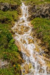 Fototapete - Swiss landscape with creek stream