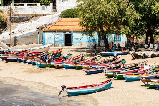 Colorful traditional wooden fishing boats on the beach of Tarrafal in Cape Verde