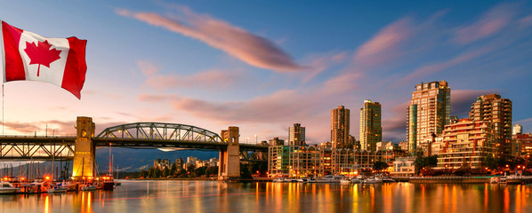 Canadian flag in front of view in Vancouver Downtown,British Columbia, Canada Wall mural