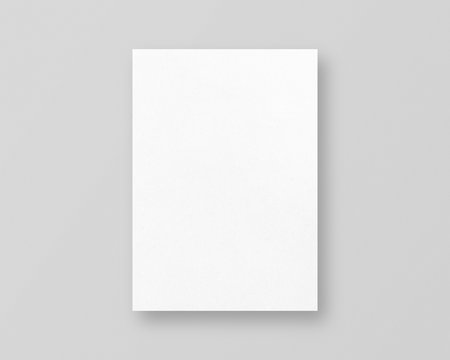 Blank white paper mockup on grey background. Empty paper photo mockup with clipping path.