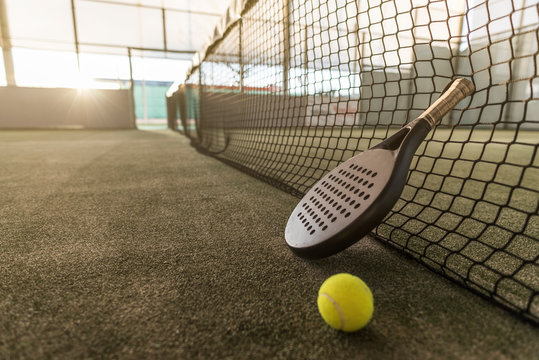 Paddle tennis image of court, racket, net and ball