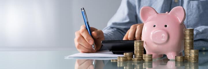 Businessman Calculating Invoice On Desk