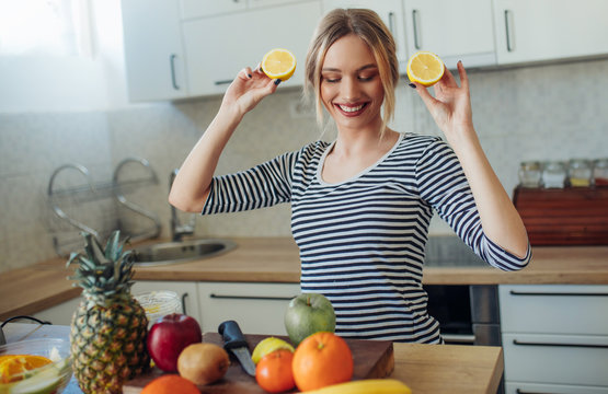 Young smiling woman with lemons
