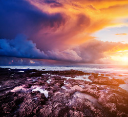 Wall Mural - Epic sunset with dark overcast sky. Location Island Sicilia.