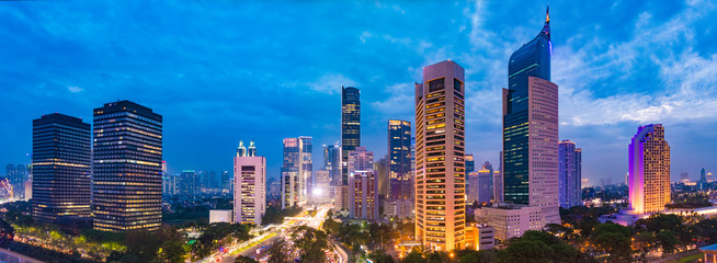 Aerial view of Jakarta's Central Business District at dusk (blue hour). Jakarta cityscape at sunset. A panorama stitched from 3 photos. Jakarta cityscape. Widescreen photo. Papier Peint