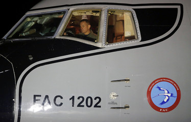 Colombian Air Force pilot is seen inside the cockpit of an airplane that will evacuate Colombian citizens from coronavirus-hit China, at the CATAM military base in Bogota