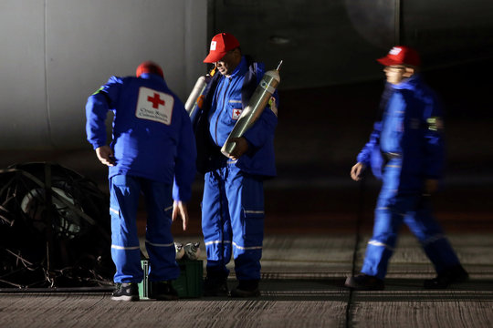Members of the Colombian Red Cross prepare medical items to be brought onboard an Air Force plane, which will evacuate Colombian citizens from coronavirus-hit China, at the CATAM military base in Bogota