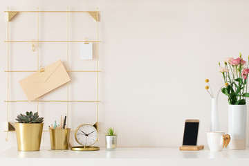 Modern office desk with gold accessories. Empty space, mock up. Minimal style.