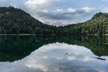 Tiny beautiful mirroring bavarian lake