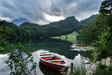 Cute boat on a calm bavarian lake in the mountains