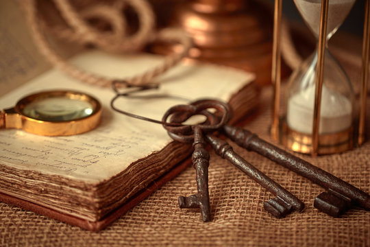 Old vintage items of the treasure hunter, traveler and discoverer - a magnifying glass, old manuscripts, a globe, keys to chests. The concept of luck, unexpected wealth, luck and romance.