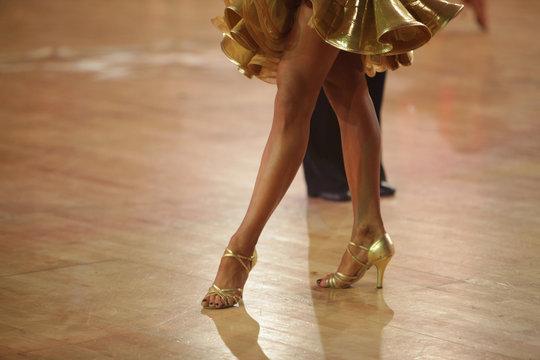 Beautiful legs of woman ballroom latin dancer in the movement