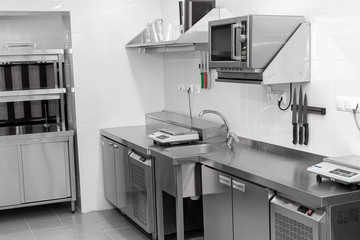 Design of the working area of the commercial cafe kitchen with stainless steel equipments, hot...