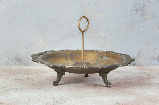 Antique brass serving dish with ring handle