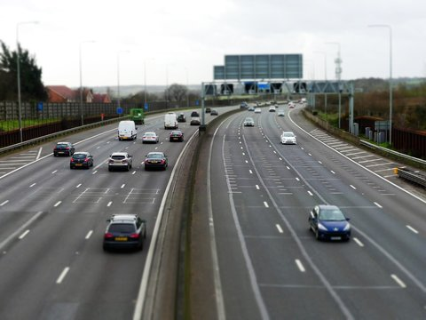 Tilt shift photograph of traffic on the M25 London Orbital Motorway between Junction 17 and Junction 18 in Hertfordshire, UK