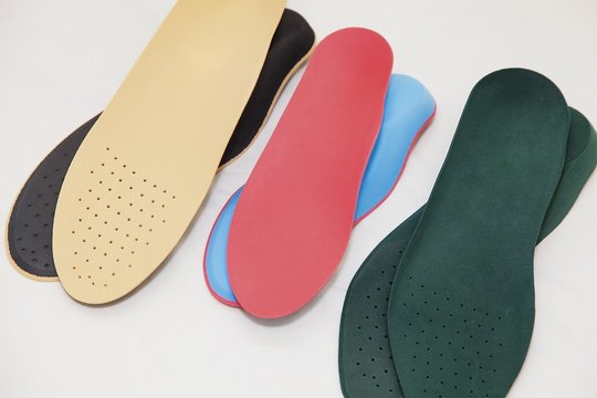 Orthopedic insoles for legs on a white background