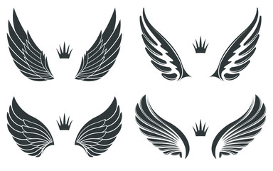 Set of four pairs of wings with crowns. Fototapete