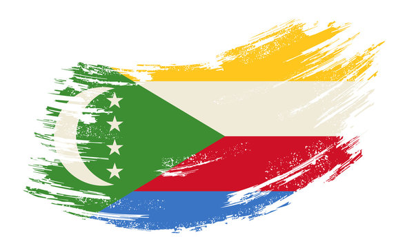 Comoros flag grunge brush background. Vector illustration.