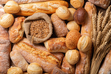 Zelfklevend Fotobehang Brood Fresh baked bread and wheat ears, top view