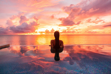 Tuinposter Koraal Paradise luxury resort honeymoon getaway destination at idyllic Caribbean tropical landscape hotel, woman silhouette swimming in infinity pool watching sunset serene. Winter getaway at dusk.