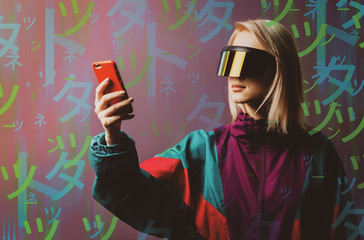 Blonde in VR glasses, mobile phone and 90s sport suit with Japanese hieroglyphs aroud