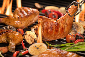 Wall Mural - Grilled chicken thigh with various vegetables on the flaming grill