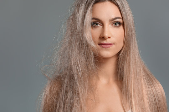 Beautiful young woman before and after hair treatment on grey background