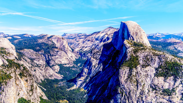 The Yosemite Valley in the Sierra Nevada Mountains with the famous Half Dome granite rock formation on the right. Viewed from Glacier Point in Yosemite National Park, California, United Sates