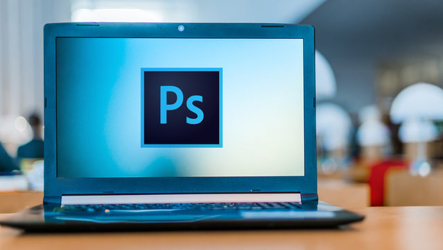 Laptop computer displaying logo of Adobe Photoshop