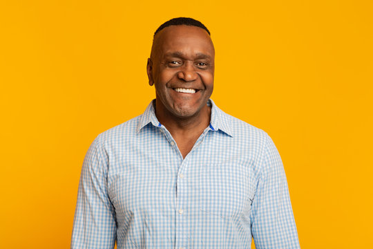 Portrait of middle aged african american man with happy smile