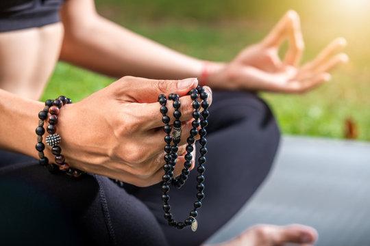 Woman in posture of Buddha during meditation. Yoga training