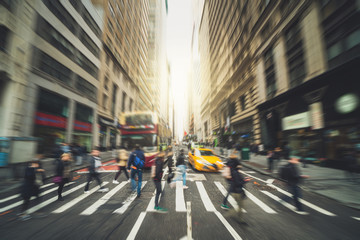 Blurred Crowd of unrecognizable business people walking on Zebra crossing in rush hour working day, New York, United States, blur business and people, lifestyle and leisure of Pedestrian concept Fotobehang
