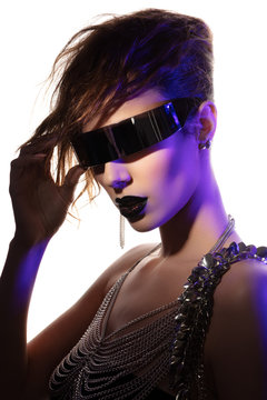 Colorful portrait of a young woman wearing futuristic glasses
