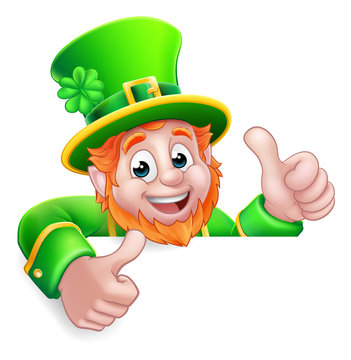 A Leprechaun St Patricks Day cartoon character giving a thumbs up and peeking over a sign.