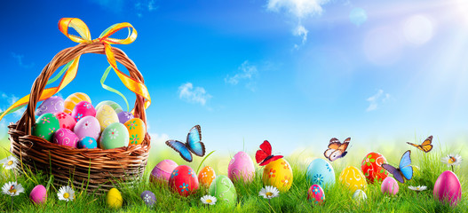 Easter - Painted Eggs In Basket On Grass With Sunny Spring Background